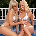 Stunning blonde hotties get naked and dildo by the pool