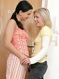 Lesbian lovers embrace and have passionate sex in hallway