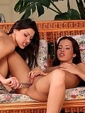 Bewitching brunettes tongue and glass dildo quims on couch