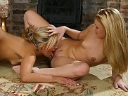 Luscious blondes lustily tongue hot pussies by fireplace