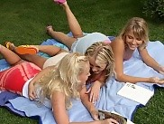 Three adorable teens undress and form daisy chain in garden