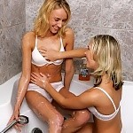 Blonde teen honeys spray and finger pink pussies in bathtub