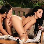 Raven haired sirens lap and dildo pink pussies on patio