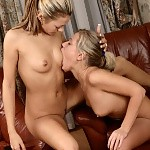 Enchanting teens tongue and dildo moist pussies in armchairs