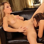Sublime beauties undress and lick smooth pussies on sofa