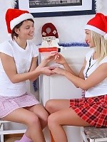 Busty cuties in Santa hats spread and dildo shaved pussies