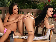 Bewitching vixens lick and dildo beautiful pussies outdoors
