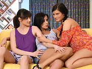 Sultry brunette trio laps and rubs fresh pussies on couch