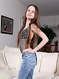 Slender teen teasingly strips and toys tight twat on couch