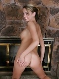 Tempting teen slowly strips and spreads quim by fireplace