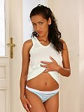Tanned hottie seductively strips and spreads her sweet pussy
