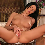 Perfect bodied vixen strips and dildos her shaved pussy