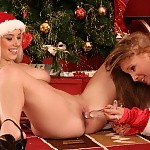 Sultry vixens in sexy Santa outfits tongue and dildo pussies