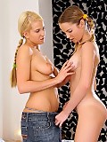 Luscious lesbians tenderly kiss and share big dildo in bed
