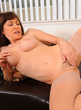 Alexandra Silk  Enticing housewife Alexandra Silk likes to finger her hot mature pussy