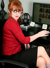 Amber Dawn  Red hot office exec Amber Dawn slides off her thong to masturbate with a dildo