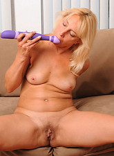 Andi Roxxx  Hot Anilos Andi Roxxx fucks her pussy with a purple sex toy until she cums