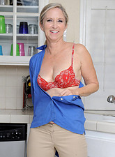 Annabelle Brady  Hot cougar gets on top of the kitchen counter and showers her shaved pussy with the dish sprayer