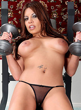After her workout at the gym Bella takes off her thong and spreads her pussy