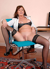 Bella Marino  While alone in the office Bella Roxxx slips her fingers deep in her cougar pussy