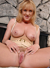 Bethany Sweet  Bethany Sweet shows some up skirt views of her hairy pussy before teasing it with a magic wand