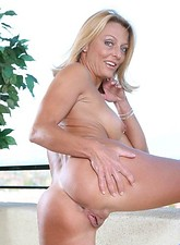 Brenda James  Long haired mature Anilos loves to expose her well mouth watering assets on the terrace