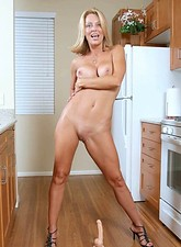 Brenda James  Orgasm starved busty milf bounces on her favorite dildo on the kitchen floor
