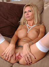 Brooke Tyler  Beautiful blonde Anilos lady shows off her big breasts and juicy milf pussy