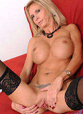 Brooke Tyler  Enticing blonde cougar Brooke Tyler likes to finger her milf pussy