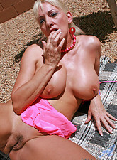 Cala Craves  Anilos blonde Cala Craves loves to caress her cock craving hairy pussy while she sunbathes outdoors