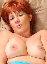 Calliste Garnet  Hot tempting redhead Calliste torments her cougar pussy with her favorite sex toy