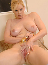 Cameron Keys  Naughty Cameron Keys pours body wash on her mature breasts and sprays her pussy with the shower head