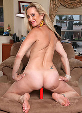 Cassy Torri  Busty blonde Cassy Torri fucks her tender cougar snatch with a big red toy
