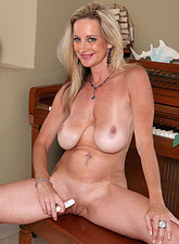 Cassy Torri  Milf Cassy Torri flaunts her big tits and pleasures herself with a purple vibrator