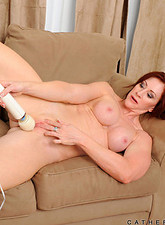 Catherine De Sade  Horny redhead Catherine Desade fucks her pussy using a magic wand on the couch