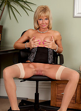 Cathy Oakely  Secretary strips in the office and bends over exposing her pussy from behind