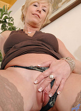 Chanel Carrera  Hot tempting blonde Chanel torments her cougar snatch with a huge black vibrator