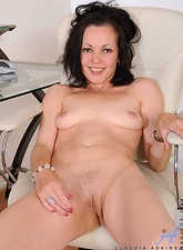 Claudia Adkins  Seductive milf Claudia Adkins enjoys banging her horny pussy with her long glass dildo at work