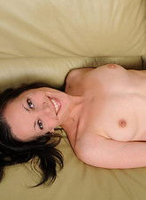 Claudia Adkins  Anilos Claudia Adkins gets totally naked on the couch and fingers her fuck hole