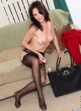 Danielle Reage  Business woman Danielle Reage loves to stuff her mature pussy with a glass dildo