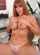 Darla Crane  Brunette Anilos Darla Crane stretches her mature pussy with a glass toy in the office