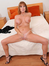 Darla Crane  Horny Darla Crane gets wild in bed as she stuffs her fingers in her hungry pussy