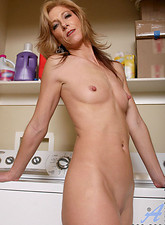 Dee Dee  Attractive mature cougar shows off her elongated nipples in the laundry room