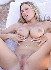 Devon Lee  Seductive Devon Lee shows off her well rounded breasts and rides a dildo until she reaches an earth trembling orgasm