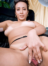 Beautiful mature cougar Diana plays with her pussy while taking a phone call in her office