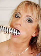 Eve Adams  Long haired milf gags on her amazingly long dildo and jams it in her savory snatch