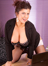 Gilly Sampson  Sultry milf Secretary strips off her office attire and spreads her hot mature snatch