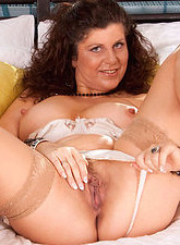 Gilly Sampson  Gorgeous Anilos Gilly flaunts her sultry nude mature body in her bedroom