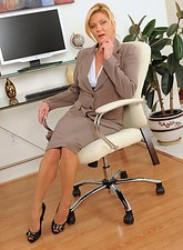 Ginger Lynn  Mature Ginger Lynn tames her horny pussy with her vibrating wand toy while she is alone in the office