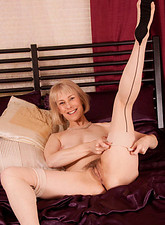 Hazel May  Horny mature blonde strokes her pink mature pussy with a glass dildo in hot solo action